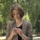 Young Attractive Concentrated Girl Is Typing Message on Smartphone in Park in Daytime, in Summer - VideoHive Item for Sale