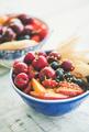Smoothie bowl with fresh black cherries