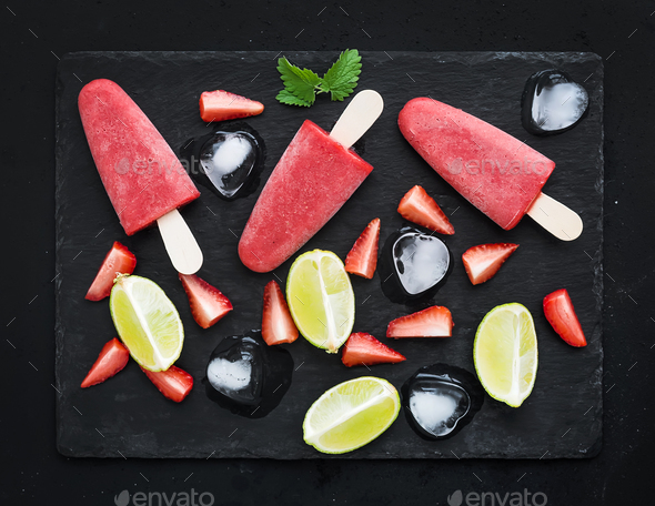 Strawberry and lime ice-creams or popsicles with fresh cut berries - Stock Photo - Images