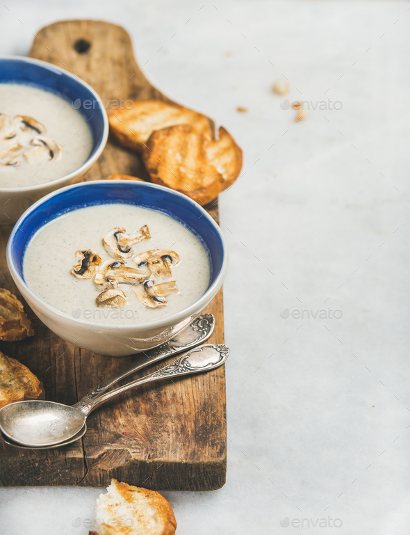Healthy dinner with creamy mushroom soup and toasted bread - Stock Photo - Images