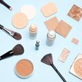 Makeup products to even out skin tone and complexion top view - PhotoDune Item for Sale