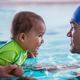 Father with baby boy in the swimming pool on swimming class - PhotoDune Item for Sale