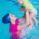 Instructor with baby boy on swimming class - PhotoDune Item for Sale