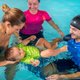 Mother with baby boy and instructors on swimming class - PhotoDune Item for Sale