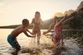 Family Enjoying Evening Swim In Countryside Lake - PhotoDune Item for Sale