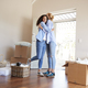 Female Friends Hugging In Lounge Of New Home On Moving Day - PhotoDune Item for Sale