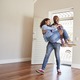 Man Carrying Woman Over Threshold Of Doorway In New Home - PhotoDune Item for Sale
