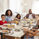 Portrait Of Two Families As They Enjoy Meal At Home Together - PhotoDune Item for Sale