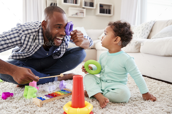 Dad and toddler son having fun playing at home, close up - Stock Photo - Images