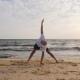 Fitness Man Practising Yoga Asana While Morning Training on Sea Beach - VideoHive Item for Sale