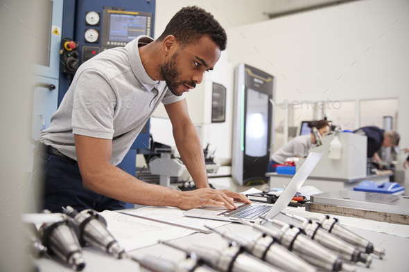 Male Engineer Using CAD Programming Software On Laptop - Stock Photo - Images