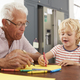 Grandad and grandson drawing together in family kitchen, close up - PhotoDune Item for Sale