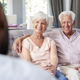 Happy senior couple taking financial advice at home - PhotoDune Item for Sale