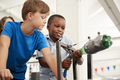 Two schoolboys using air pressure rocket at a science centre - PhotoDune Item for Sale