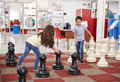 Schoolchildren playing giant chess at a science centre - PhotoDune Item for Sale