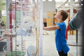 Young boy standing looking at a science exhibit, side view - PhotoDune Item for Sale
