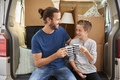 Father And Son Take A Break In Back Of Removal Van On Moving Day - PhotoDune Item for Sale