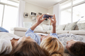 Mother And Children Lying On Rug And Posing For Selfie At Home - PhotoDune Item for Sale