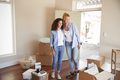 Female Friends Standing In Lounge Of New Home On Moving Day - PhotoDune Item for Sale