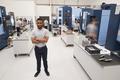 Portrait Of Male Engineer On Factory Floor Of Busy Workshop - PhotoDune Item for Sale