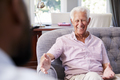 Happy senior man taking financial advice at home - PhotoDune Item for Sale