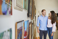 Couple Looking At Paintings In Art Gallery Together - PhotoDune Item for Sale