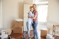 Happy Couple Surrounded By Boxes In New Home On Moving Day - PhotoDune Item for Sale