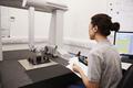 Female Engineer Uses CMM Coordinate Measuring Machine In Factory - PhotoDune Item for Sale