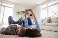 Couple Lying On Rug And Posing For Selfie At Home - PhotoDune Item for Sale