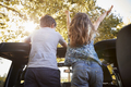 Children Standing Up In Back Of Open Top Car On Road Trip - PhotoDune Item for Sale