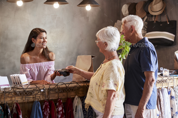 Senior Customers Buying Goods In Store Using Contactless Payment - Stock Photo - Images