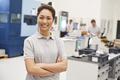 Portrait Of Female Engineer On Factory Floor Of Busy Workshop - PhotoDune Item for Sale