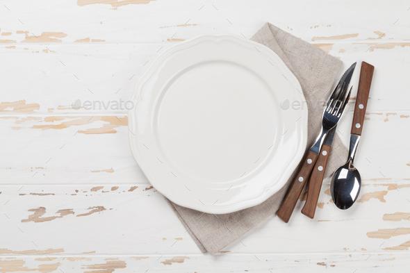 Empty plate with silverware Stock Photo by karandaev | PhotoDune