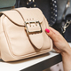 Woman buying a leather handbag. - PhotoDune Item for Sale