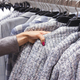 Woman choices a wool coat on hangers in the store. - PhotoDune Item for Sale