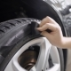 Shot of a Man Wiping Tire After Cleaning on Car Washing Station. - VideoHive Item for Sale