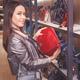 Excited female customer purchasing new handbag in shop - PhotoDune Item for Sale