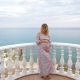A Pregnant Girl Stands on the Balcony Next To the Sea and Caresses Her Tummy. - VideoHive Item for Sale