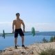Muscular Crossfit Sportsman in Hat Training with Barbell on the Hill. - VideoHive Item for Sale