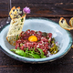 Delicious steak tartare with yolk, capers, green onion and bread - PhotoDune Item for Sale