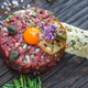 Close view of beef tartare and quail egg yolk - PhotoDune Item for Sale