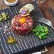 Steak tartare served with capers, pickled cucumbers and chopped onion. - PhotoDune Item for Sale