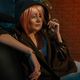 Girl with pink hair sitting relaxed on a leather sofa - PhotoDune Item for Sale