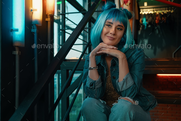 Girl portrait with stylish blue hair and pretty face expression - Stock Photo - Images