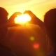 Romantic Couple at Sunset Show a Heart Shape From Hands. - VideoHive Item for Sale