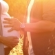Pregnant with Her Partner Hugging Her and Holding Her Belly Outdoors. - VideoHive Item for Sale