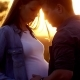 Pregnant with Her Partner Hugging Her and Holding Her Belly Outdoors - VideoHive Item for Sale