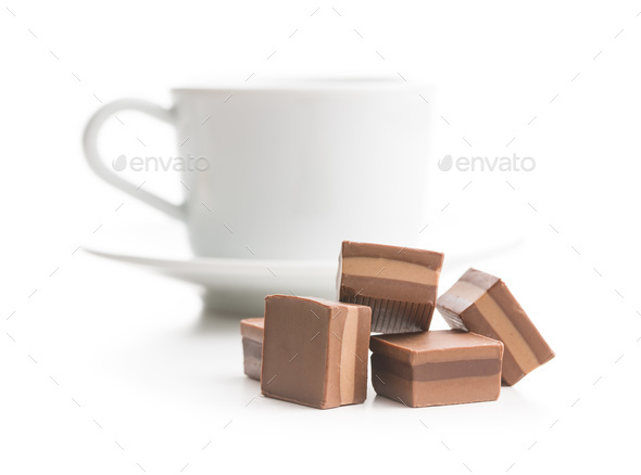Sweet nougat pralines and coffee cup. - Stock Photo - Images
