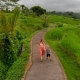 A Young Woman and Her Son Walking Along Beautiful Rice Terraces on the Bali Island - VideoHive Item for Sale