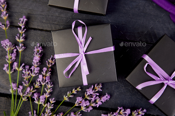 Black Gift box with violet ribbon - Stock Photo - Images